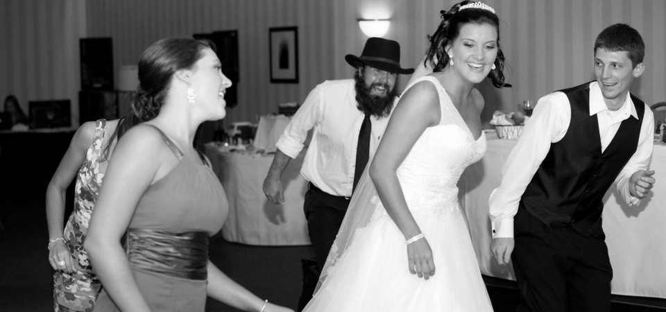 Bride with guests dancing to music